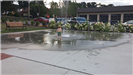 Boy Playing in Water Fountain