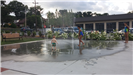Kids Playing in Water Fountain